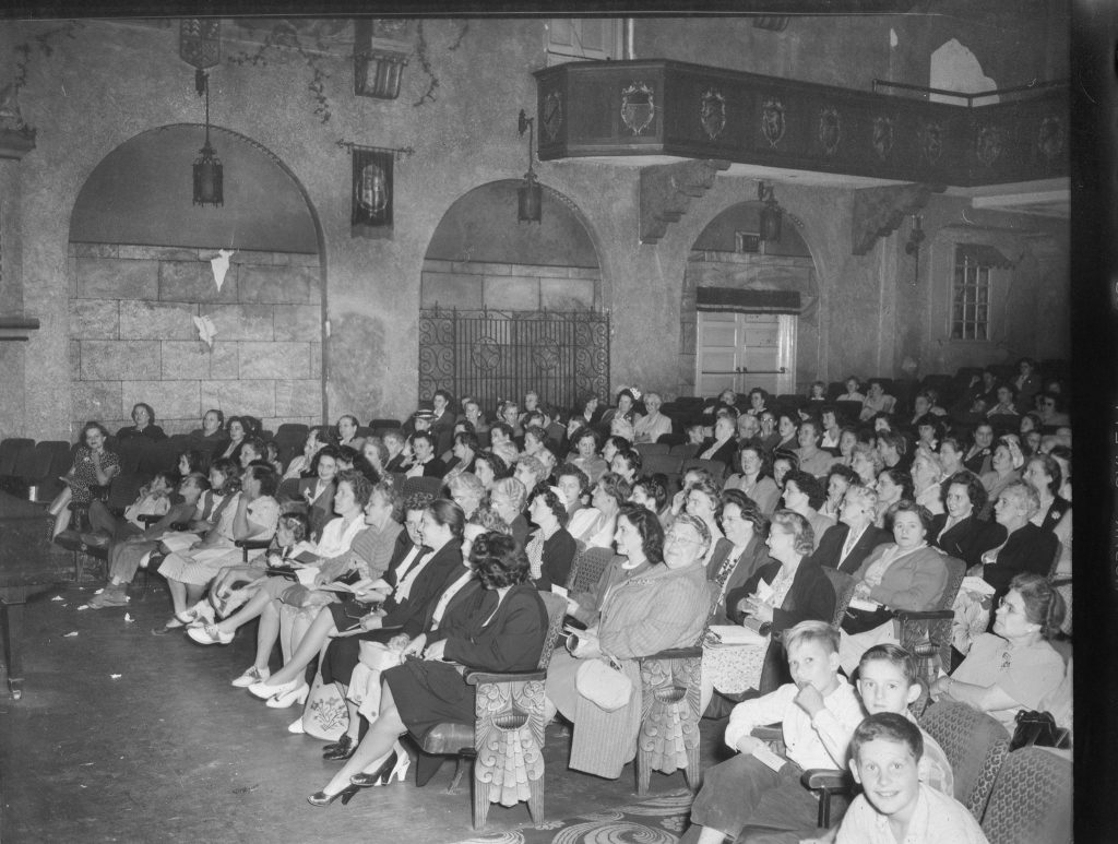 Audience watching show at theater